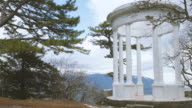 White rotunda on the background of blue mountains video