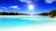 White sand beach and lagoon at tropical island video