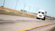 White Semi Truck Driving Down The Highway video