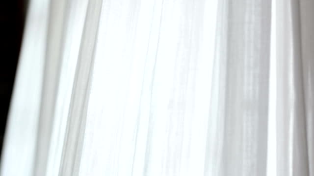 White sheer curtain blowing video