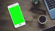 White Smartphone on Desk with Chroma Key Green Screen video