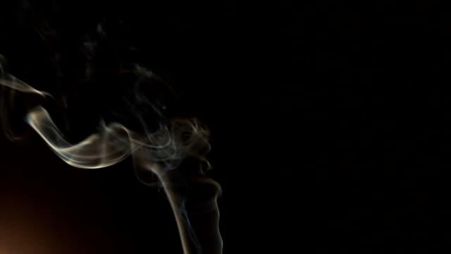 white smoke on a black background video
