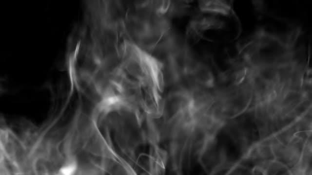 White smoke on black background flows seamless loop video