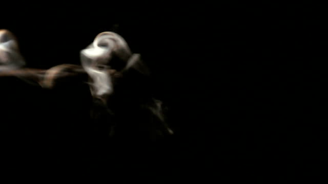 white smoke on black background video