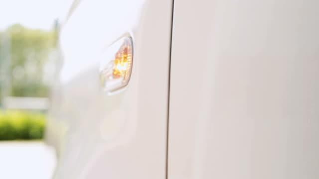 White van flashing turn signal video HD video