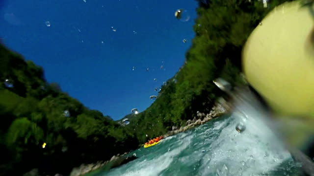White water rafting first point of view, personal perspective, Adventure Extreme Sports Leisure Activity Gopro. On board camera, slow motion video