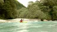 HD: Whitewater Kayaker Rolling In The Rapids video