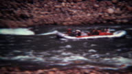 1972: Whitewater rafting guided tour down fast moving mountain river. video