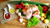 Whole raw chicken with vegetables and kitchen scales video
