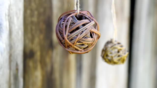 Wicker balls over grey barn wood video