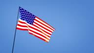 wide angle of USA flag blue sky video