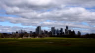 Wide Angle Passing Cloudscape Zilker Park Austin Texas 2016 on a perfect day in early spring as the sun comes out and clouds bring rain and grass turns green Capital City Skyline video