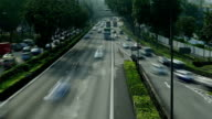Wide angle shot time lapse of highway traffic in the morning rush hour video