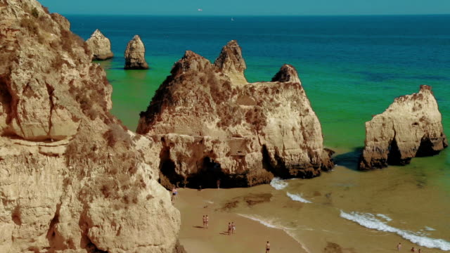 Wide Angle Steady Shot of a Rocky Beach with Tourists in the Algarve, Portugal video