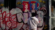 Wide Shot of Graffiti Artist Painting Urban Wall video