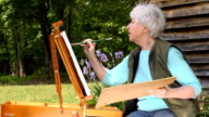 Wide Shot of Senior Woman Painting video