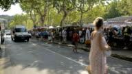 Wide shot of St-Tropez farmers market from across street. video