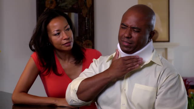 Wife Comforting Injured Husband in Neck brace video
