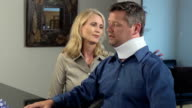 Wife Comforts Injured Husband in Neck brace video