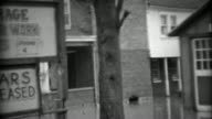 1936: Wilson's Garage general repair work on all cars flooded from storm. video