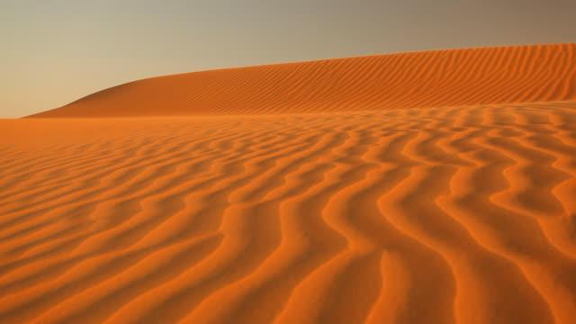 wind blowing sand in desert loop video