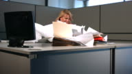 Wind blows papers in office, slow motion video