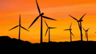 Wind farm turbines in sunset video