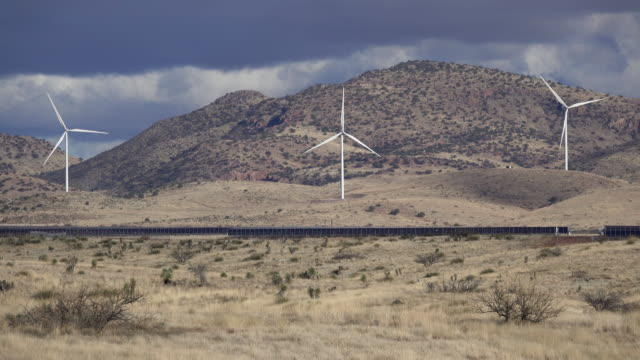 Wind farm turbines solar panels Wilcox Arizona Sonoran Desert Mountains video