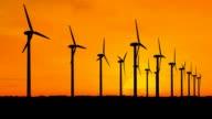 Wind generators over orange sky video
