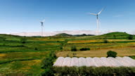 Wind power plants on a green hills in Portugal aerial view video