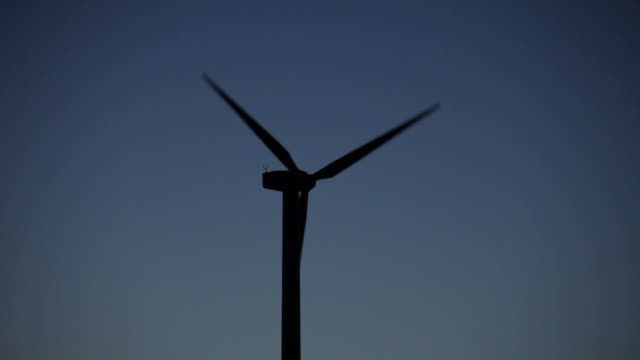Wind turbine against a blue sky at dusk, The Netherlands video