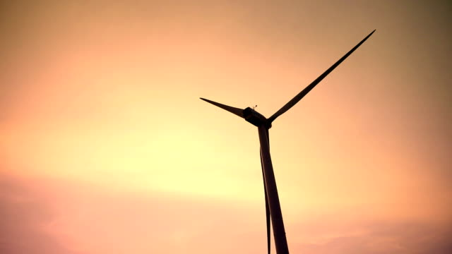 Wind turbine at sunset video