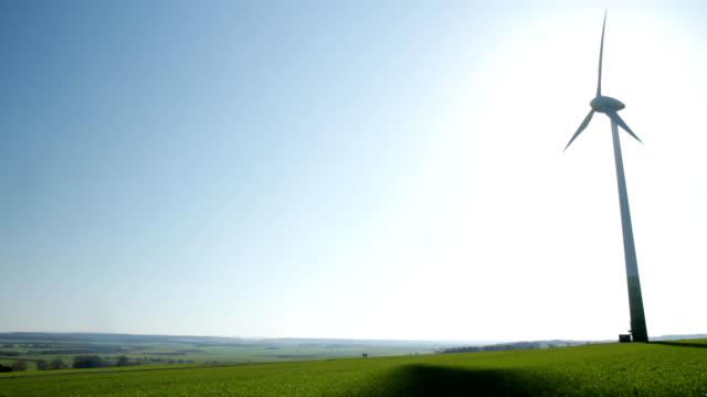 Wind Turbine back lit by Sun video