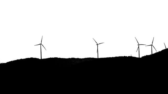 Wind turbine silhouette on horizon LOOP. video