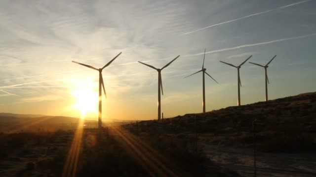 Wind Turbines at Sunrise With Sun Flare video