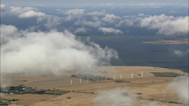 Wind Turbines From Above the Clouds  - Aerial View - Mecklenburg-Vorpommern,  Landkreis Vorpommern-Rügen,  Germany video