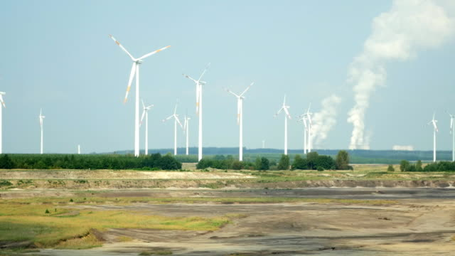 T/L Wind Turbines In Front Of Coal Power Plant video