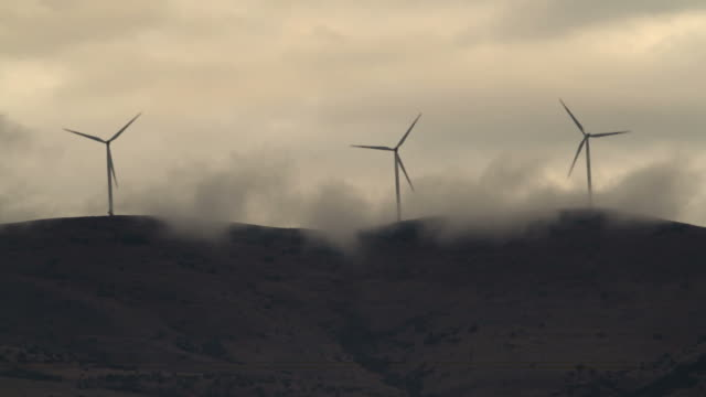 wind turbines on cloudy mountains video