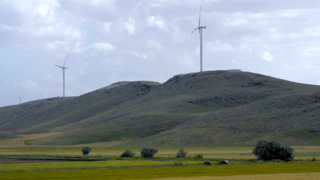 Wind turbines on the hills video