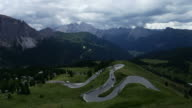 Winding road through the fields of Dolomites Alps valley video
