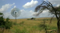 Windmill and an old house in African Safari video