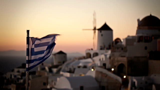 Windmill at sunset in Oia Village. Santorini. Greece. video