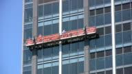Window Repairmen Working On Office Building video