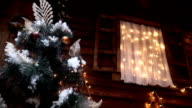 A window view of the Christmas tree video