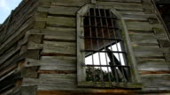 window with an iron gate in the old wooden church video
