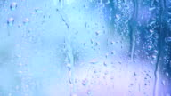 Window with Raindrops over Blue video