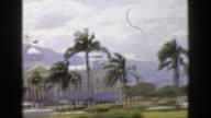 1957: Windy storm Caribbean tropical mountainous terrain palm tree royal government civic building video