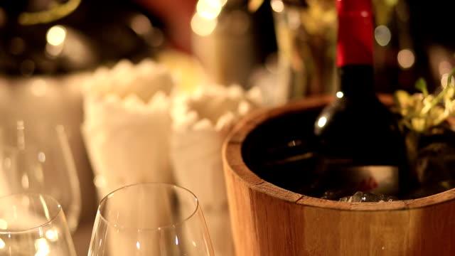 wine bottle in wood bucket video