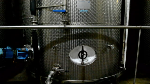 Wine Fermenting in huge vats in a wine video