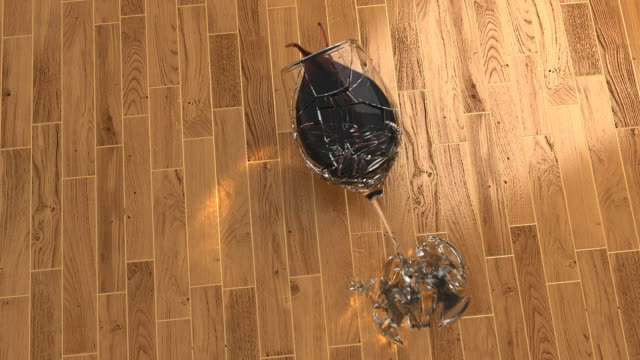 Wine glass smashing on wood floor video